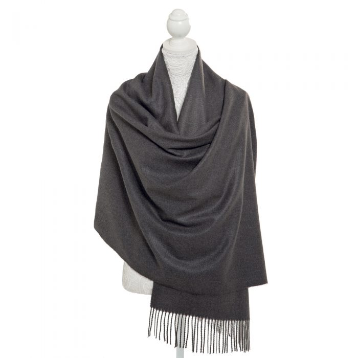 Finish off your outfit perfectly with a touch of elegance from our wonderfully soft charcoal grey pashmina. Warm, cosy and generous in size, the pashmina drapes beautifully making it just perfect for accessorising with your outfit. 100% polyester with fringed edges. Presented tissue wrapped within an organza bag.